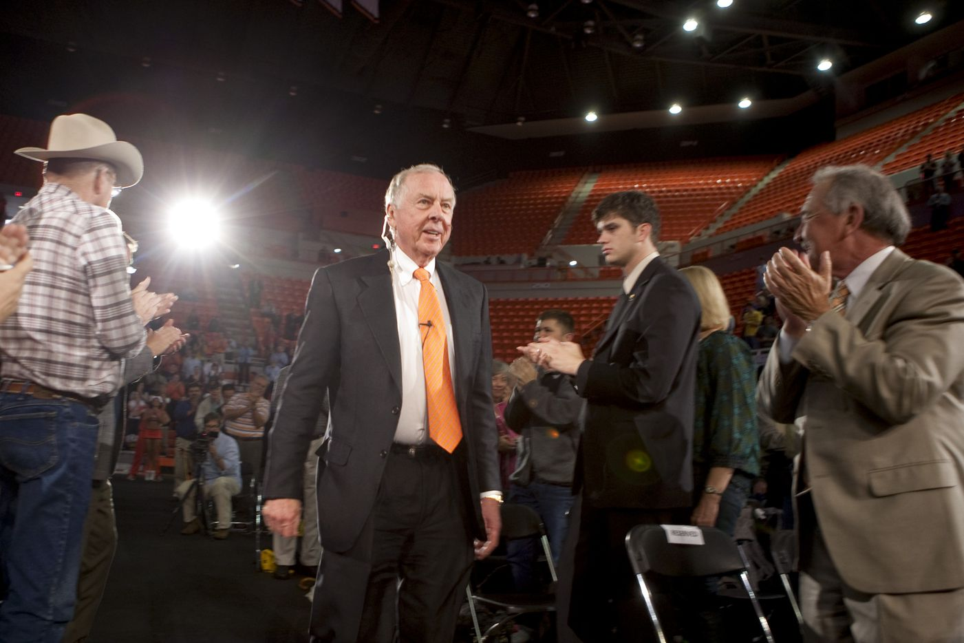 Pickens, center, arrives for a town hall meeting at Oklahoma State University's Gallagher-Iba Arena in Stillwater in 2009. Pickens was promoting the Pickens Plan, a grass-roots alliance that promotes the use of wind and natural gas power to reduce dependence on foreign oil.