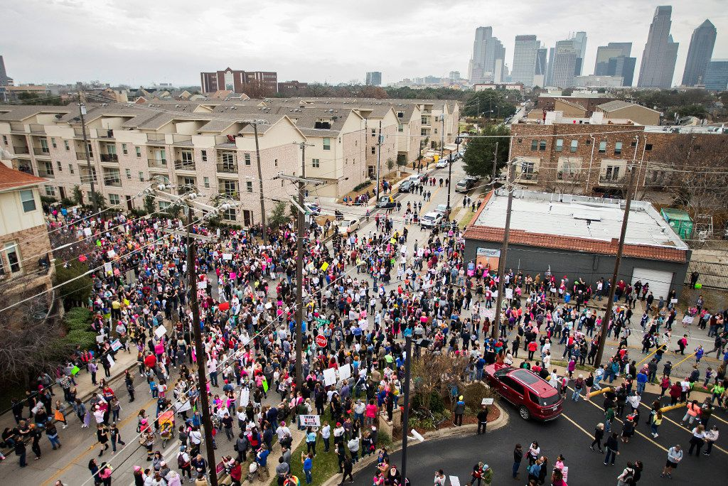 Marchers jam the intersection outside the at the Communications Workers of America Hall at the end of the Dallas Women's March.