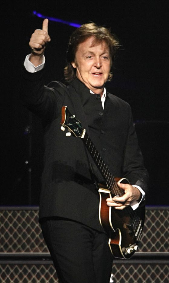 Former Beatle Paul McCartney acknowledges the crowd during his performance at the new Dallas Cowboys Stadium in Arlington, Wednesday, August 19, 2009.