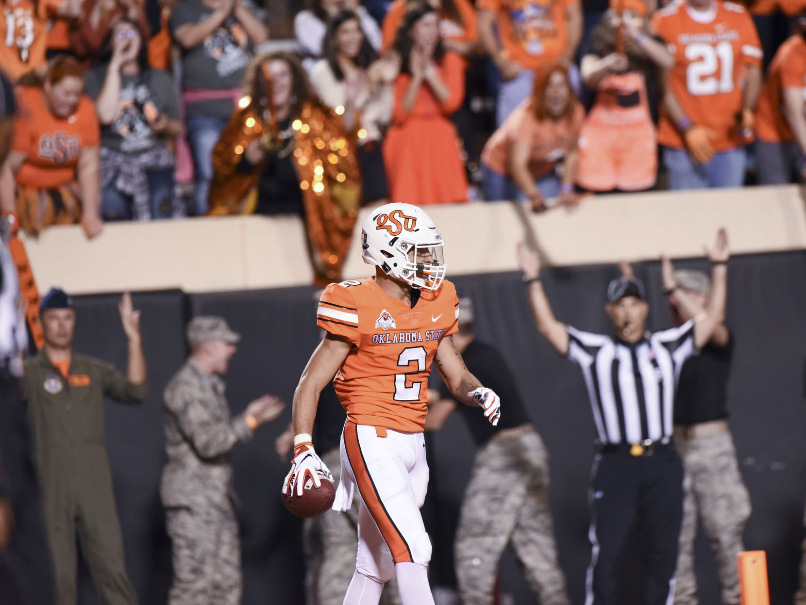 FILE - Oklahoma State wide receiver Tylan Wallace (2) walks after scoring a touchdown in the first half of an NCAA college football game in Stillwater, Okla., Saturday, Oct. 27, 2018. (AP Photo/Brody Schmidt)