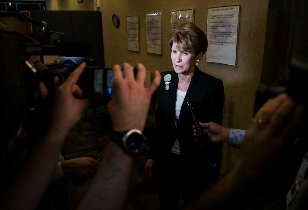 Former Dallas Mayor Laura Miller speaks to reporters as she leaves the city secretary's office after filing the required petition signatures to secure a place on the ballot for Dallas City Council District 13 on Feb. 15, 2019, at Dallas City Hall.