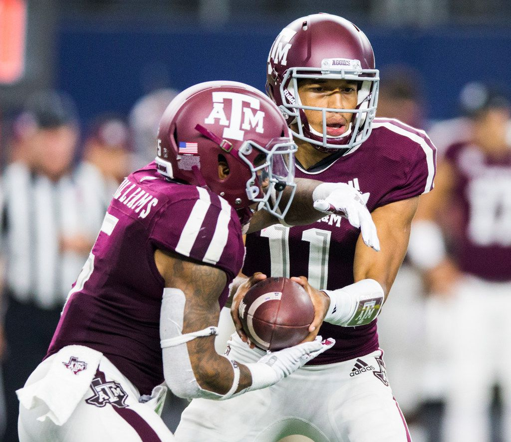Texas A&M Aggies quarterback Kellen Mond (11) hands off the ball to running back Trayveon Williams (5) during the second quarter of an NCAA football game between Texas A&M and Arkansas on Saturday, September 29, 2018 at AT&T Stadium in Arlington, Texas. (Ashley Landis/The Dallas Morning News)