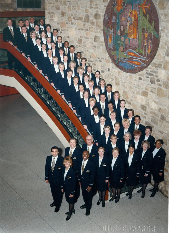 American Airlines flight attendants graduating in 2001 pose for a photo on the staircase at the Stewardess College.