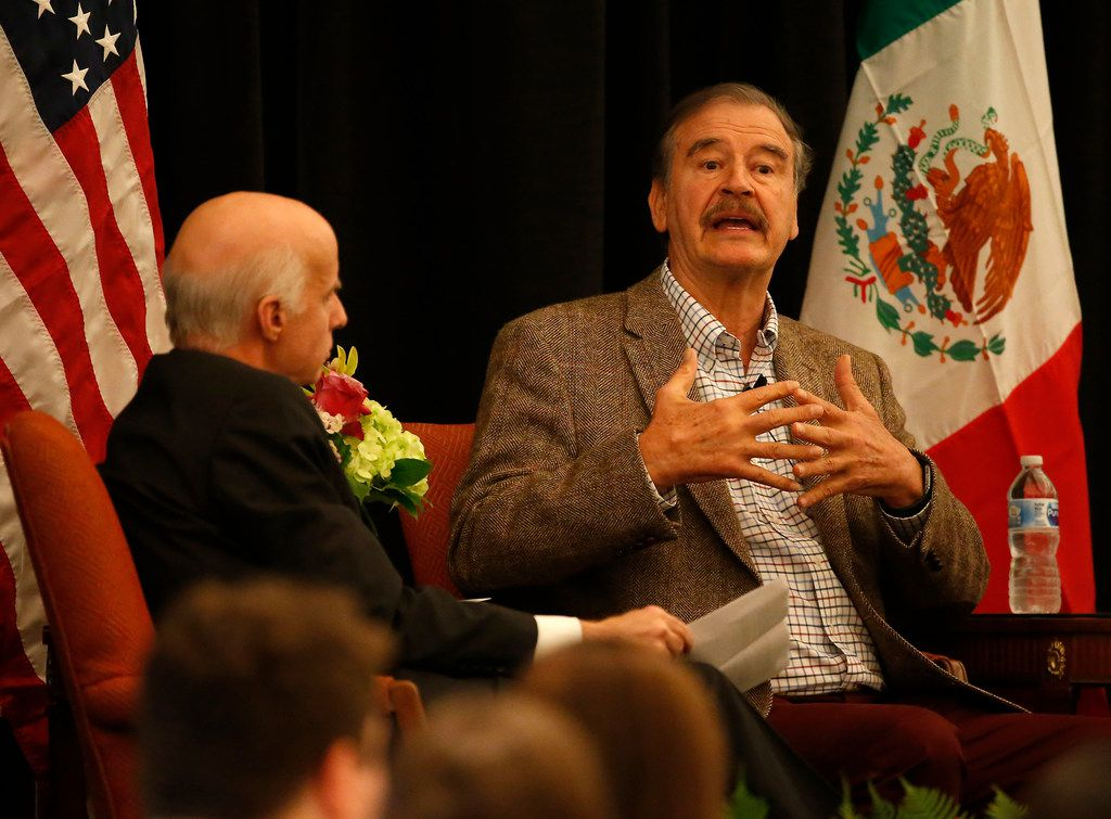 Former Mexican President Vicente Fox, right, speaks during the World Affairs Council's International Educator of the Year event at Belo Mansion in Dallas, Monday, Feb. 19, 2018.