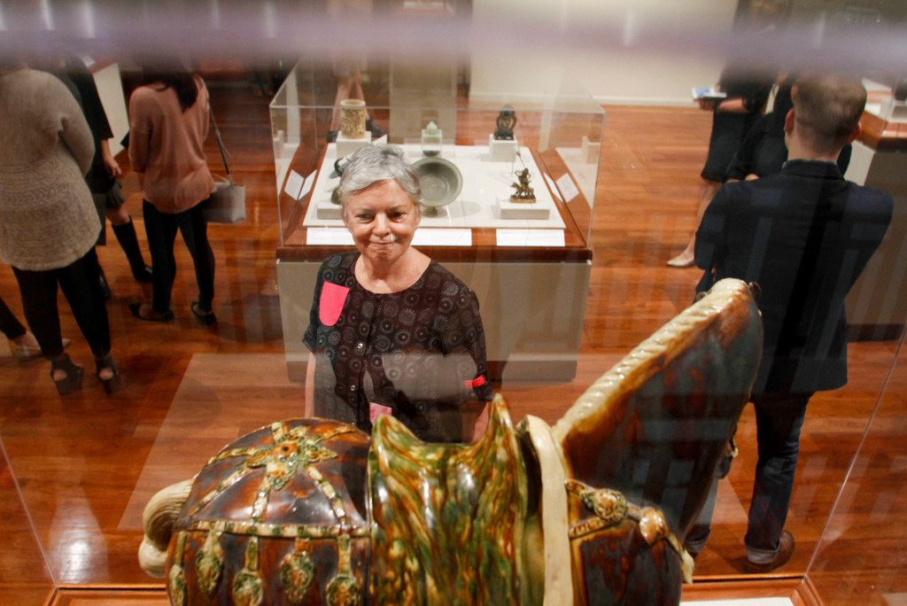 """Curator Emeritus for the Crow Museum of Asian Art, Caron Smith, looks at an art piece titled """"Horse with ornamental Trappings"""" on display in the Asian Art Museum The Crow at Twenty exhibit at the Crow Museum of Asian Art in Dallas on Wednesday, September 26,2018. (Brian Elledge/The Dallas Morning News)"""