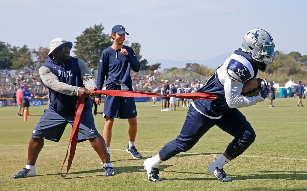 Dallas Cowboys running back Ezekiel Elliott, right, practices with running backs coach Gary Brown at the training camp in Oxnard, Calif., Sunday, July 29, 2018. (Jae S. Lee/The Dallas Morning News)
