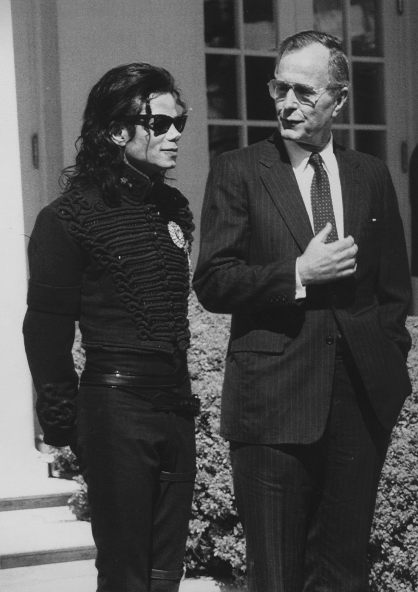 """1990: President George H. W. Bush meets with singer Michael Jackson at the White House. Jackson was in Washington, D.C., to be presented with the """"Entertainer of the Decade"""" award by the Friends of the Capital Children's Museum."""