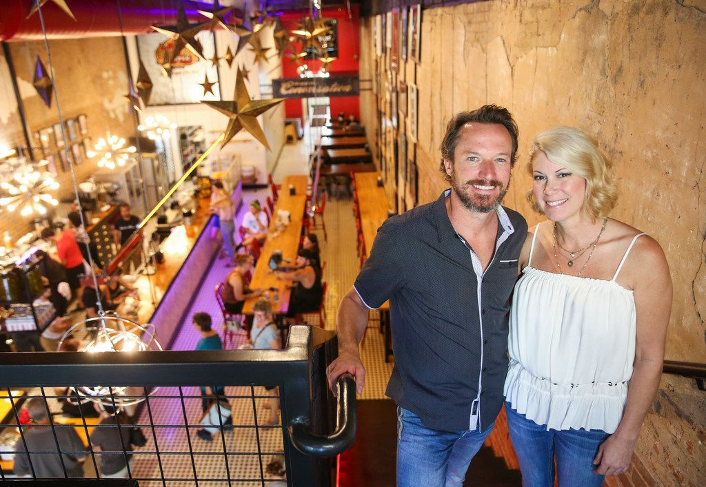 Jupiter House co-owner Joey Hawkins, left, and Amy Hawkins pose for a photograph on Thursday, May 16, 2019 at Jupiter House coffee shop in Denton, Texas. (Ryan Michalesko/The Dallas Morning News)