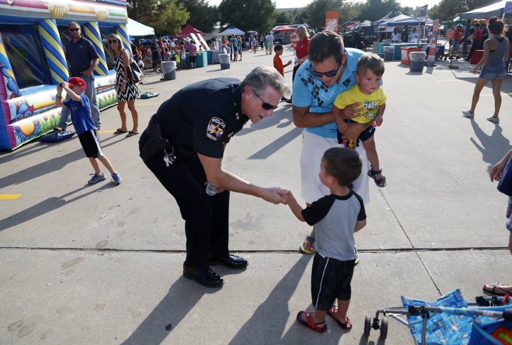 Rockwall Police Chief Kirk Riggs met Aaron Gonzalez and his sons, Tanner Gonzalez, 1, and  Carter Gonzalez, 3,  during a National Night Out event at a Home Depot parking lot in Rockwall in 2015.