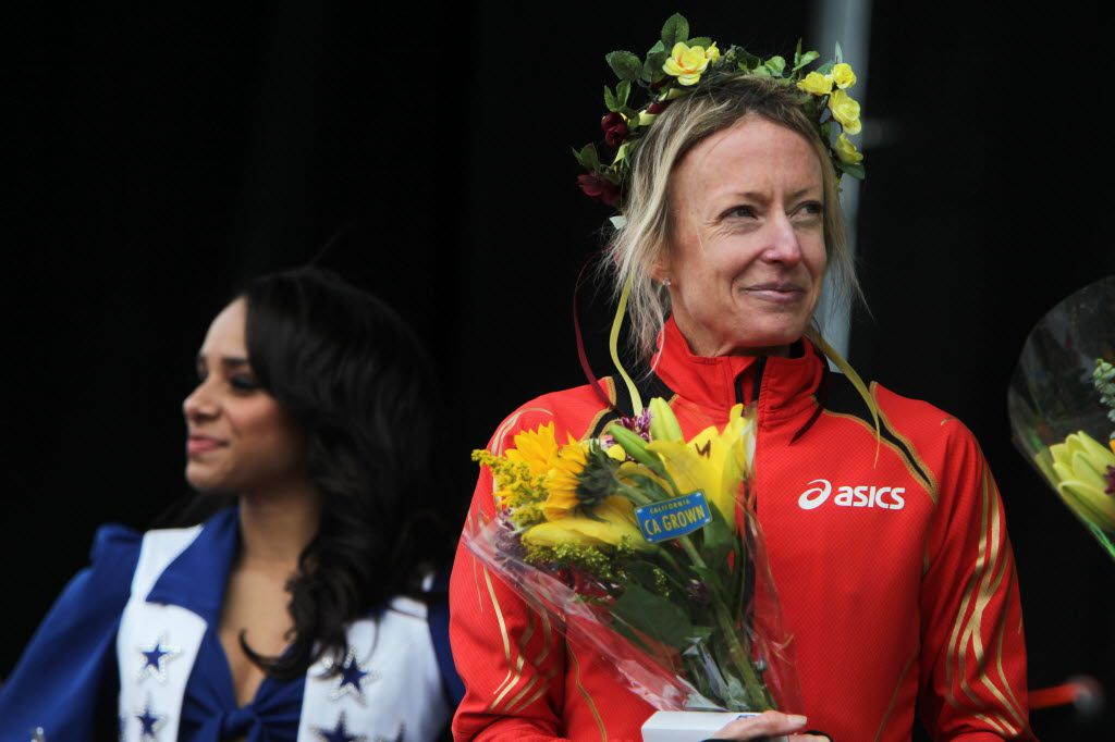 Olympic medal winner Deena Kastor, who finished first in the women's division with a time of 1:11:57, is honored onstage during the Dallas Rock N' Roll half-marathon on Sunday, March 23, 2014. (Matthew Busch/The Dallas Morning News)