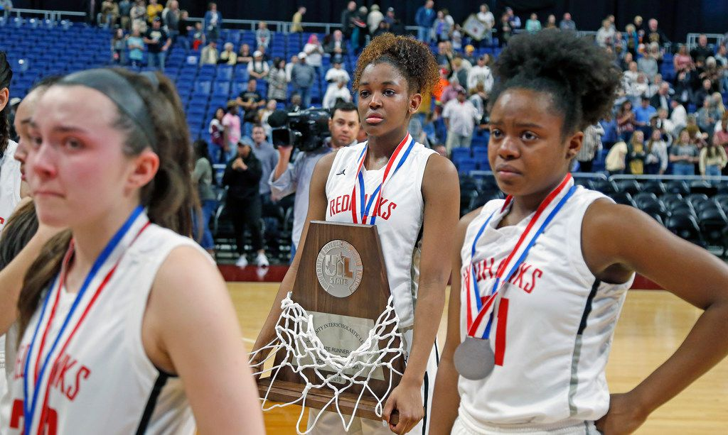 Liberty's Randi Thompson walks off with their second place trophy after losing to Amarillo. UIL girls basketball 5A State final between Frisco Liberty and Amarillo on Saturday,  March 2, 2019 at the Alamodome in San Antonio, Texas. (Ron Cortes/ Special Contributor) ORG XMIT: 10043974A