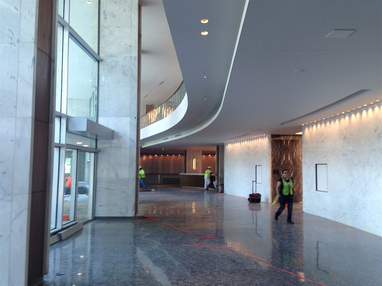 Work crews finish up the lobby in The Statler in downtown Dallas.