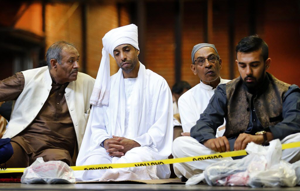 Men from left, Abdul Hakeem of Coppell, Khidir Hamad of Richardson, Mohammad Ilyas of Garland and his son Aamir Saipullai of Garland gathered for prayer in the Centennial Building at Fair Park for Eid al-Fitr to celebrate the end of the Muslim holiday Ramadan, Wednesday, July 6, 2016 in Dallas. Ramadan is the Islamic holy month of fasting. (Tom Fox/The Dallas Morning News)