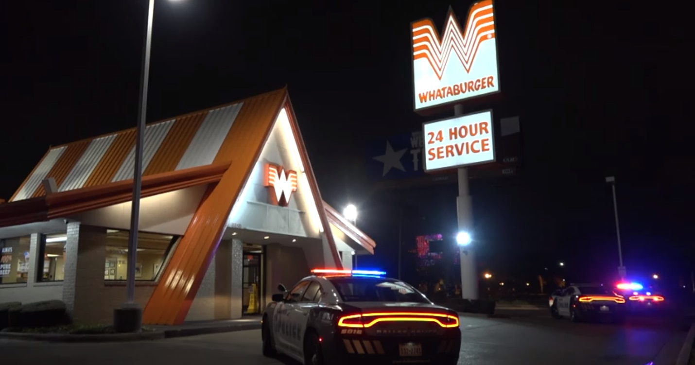 Dallas police cars at the scene of a robbery at the Whataburger on Stemmons Freeway near Regal Row early Sunday, March 24, 2019