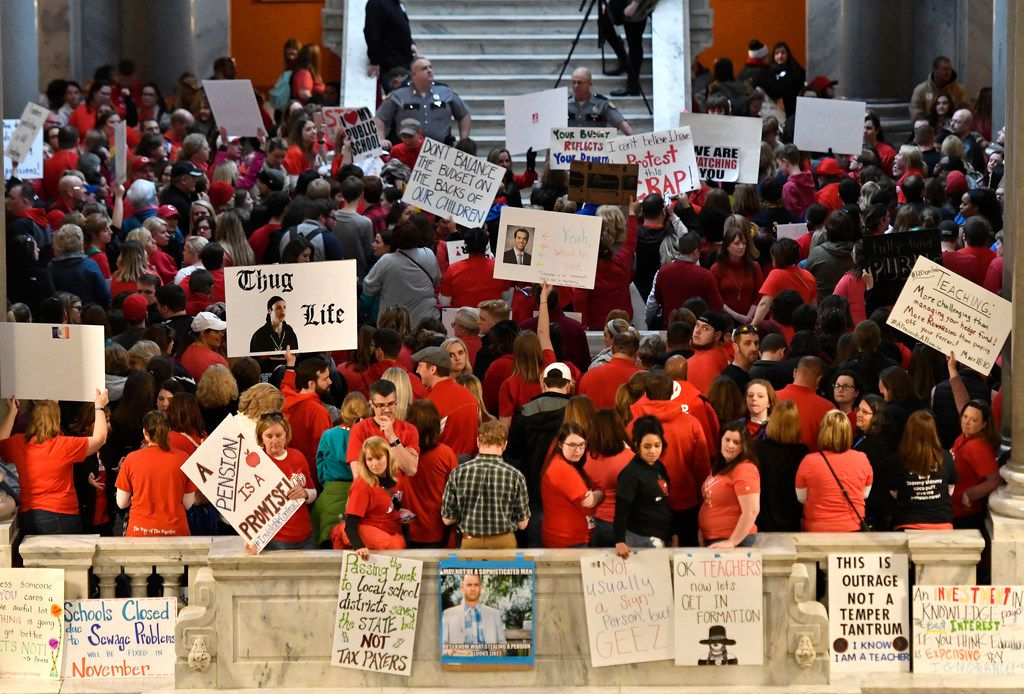 Teachers from across Kentucky stand at the base of the steps leading to the Kentucky State Senate chamber as they rally for increased funding and to protest last minute changes to their state funded pension system, Monday, April 2, 2018, in Frankfort, Ky.