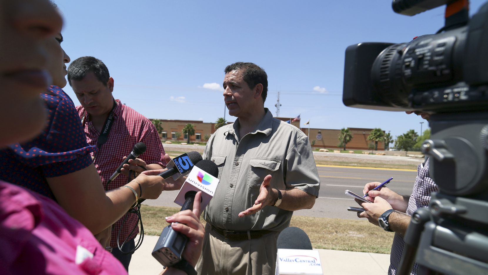 Rep. Henry Cuellar (D-Texas), co-sponsor of a bill intended to make it easier to send migrant children back to their home countries, outside the U.S. Customs and Border Patrol facility in Hidalgo, Texas, June 14, 2014. The bill, also sponsored by Sen. John Cornyn (R-Texas), would allow children from Central American countries to opt to be voluntarily sent home. (Jennifer Whitney/The New York Times)