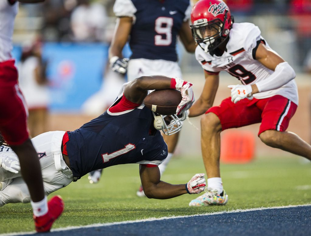 Allen running back Celdon Manning (1) reaches over the goal line for a touchdown during the first quarter of a high school football game between Allen and Cedar Hill on Friday, August 30, 2019 at Eagle Stadium in Allen. (Ashley Landis/The Dallas Morning News)