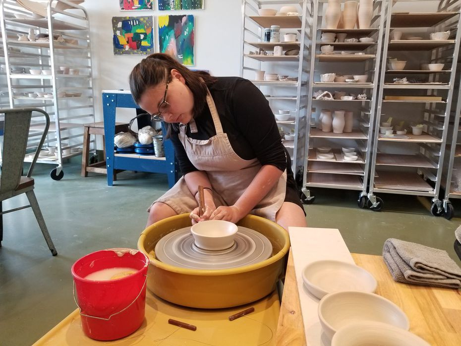 Instructor Emily Davis demonstrates pottery-making techniques at Blackberry Mountain.