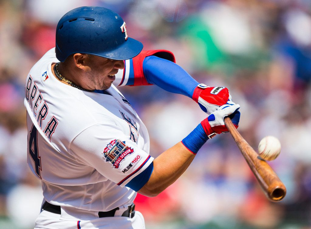 Texas Rangers third base Asdrubal Cabrera (14) bats during the second inning of an opening day MLB game between the Texas Rangers and the Chicago Cubs on Thursday, March 28, 2019 at Globe Life Park in Arlington, Texas. (Ashley Landis/The Dallas Morning News)