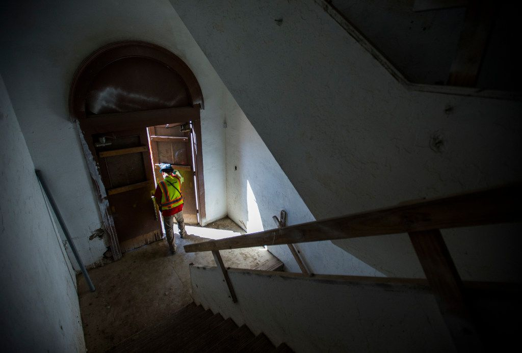 A worker exits the building as construction crews work on the old Dallas High School building on Thursday, July 27, 2017 on Bryan Street in downtown Dallas. The 108-year-old building is now an office and retail space. (Ashley Landis/The Dallas Morning News)