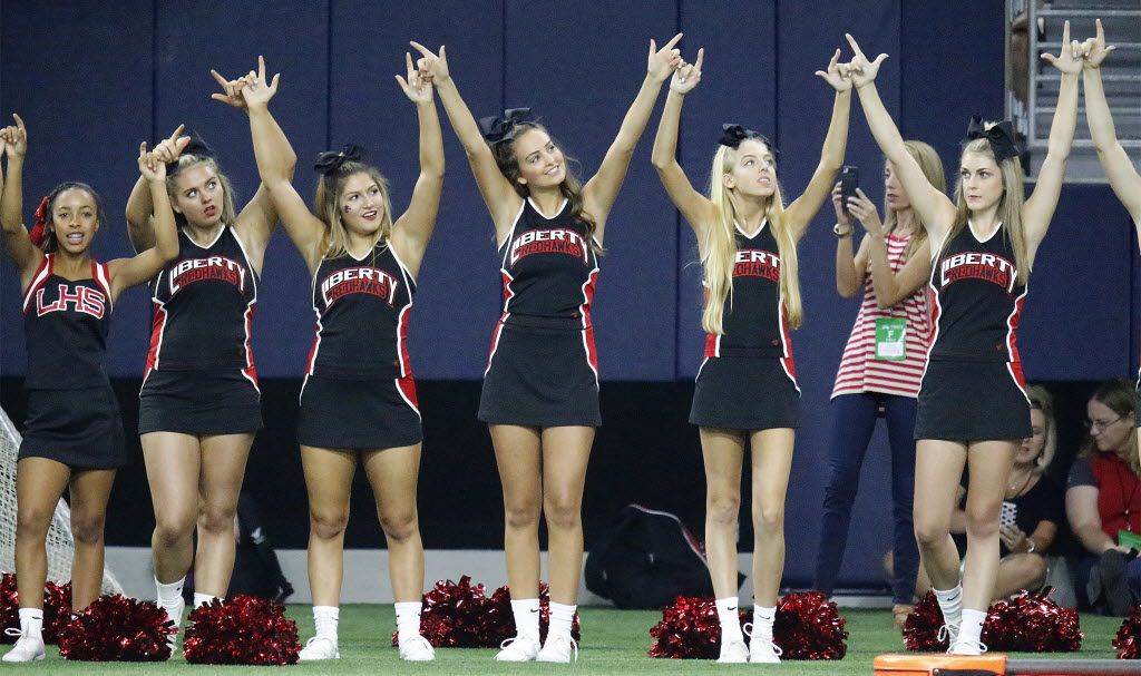 Liberty High School cheerleaders anticipate kickoff at The Star in Frisco on August 27, 2016.