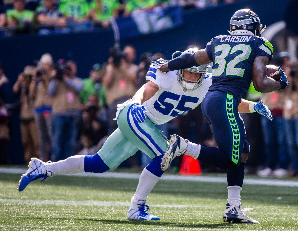 FILE - Cowboys linebacker Leighton Vander Esch (55) tackles Seahawks running back Chris Carson (32) during the first half of a game at CenturyLink Field on Sunday, Sept. 23, 2018, in Seattle. (Smiley N. Pool/The Dallas Morning News)