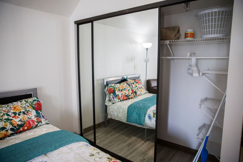 The closet and bed inside a room at St. Jude Center, a senior-living facility for homeless and veterans on Thursday, August 23, 2018. The Dallas Housing Authority was supposed to fill the facility with residents using vouchers, but vouchers are not available due to lack of funding. (Ashley Landis/The Dallas Morning News)