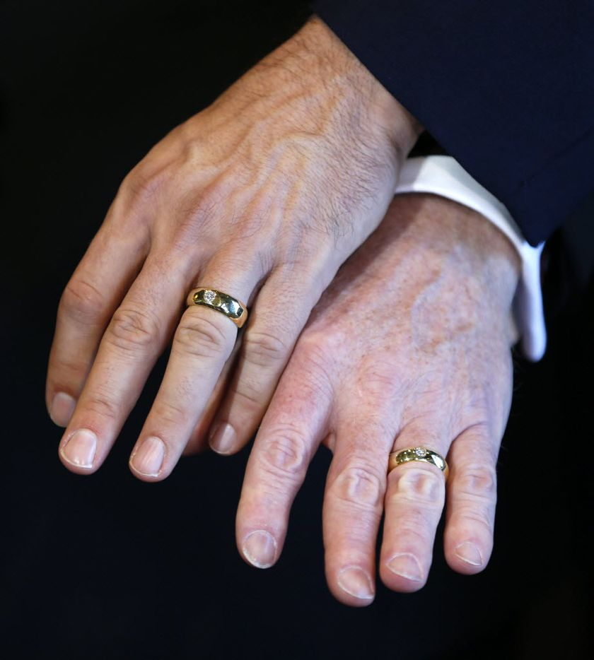 Vic Holmes (left hand) and Mark Phariss show their wedding rings to the media after they were married at the Westin Stonebriar Hotel in Frisco on Nov. 21, 2015. Pharris and Holmes were the plaintiffs who sued the state for the right to marry in DeLeon vs. Perry. (Vernon Bryant/The Dallas Morning News)