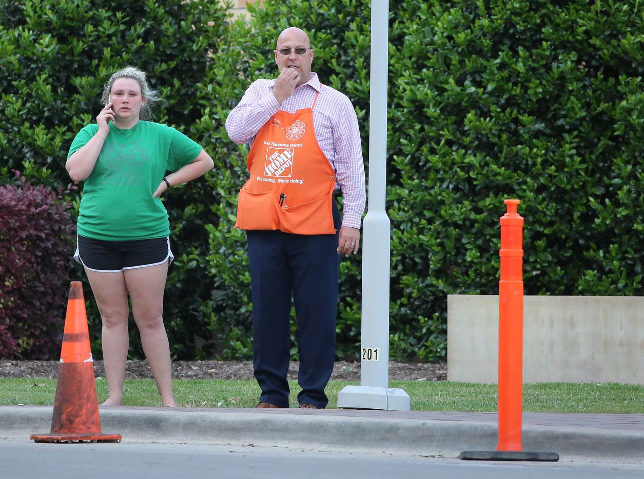 Two persons stand at the entrance to the emergency room at Presbyterian Hospital in Dallas. Two Dallas policemen were reportedly shot at a nearby Home Depot and reportedly were transported to the Dallas hospital on April 24, 2018.