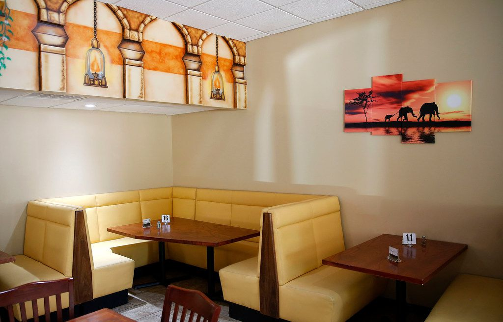 The dining area at Iby restaurant in Richardson is colorful and cozy.