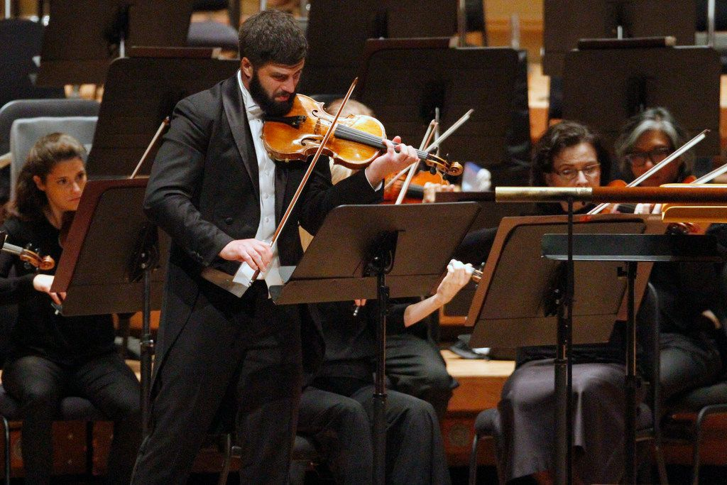 """Dallas Symphony Orchestra co-concertmaster Nathan Olson doubles as soloist and conductor in """"Summer,"""" from Astor Piazzolla's """"Four Seasons of Buenos Aires,"""" during a DSO concert celebrating the 30th anniversary of the Meyerson Symphony Center."""