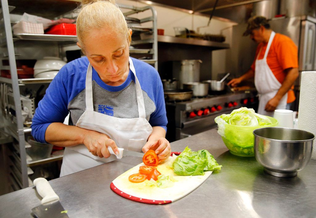 Lily Arias (left) and her husband, Aurelio Arias, prepare tortas at El Palote, a vegan Mexican restaurant they own in Pleasant Grove. The restaurant is bringing veganism to traditional Mexican dishes after a family health crisis motivated the couple to change their dietary habits.