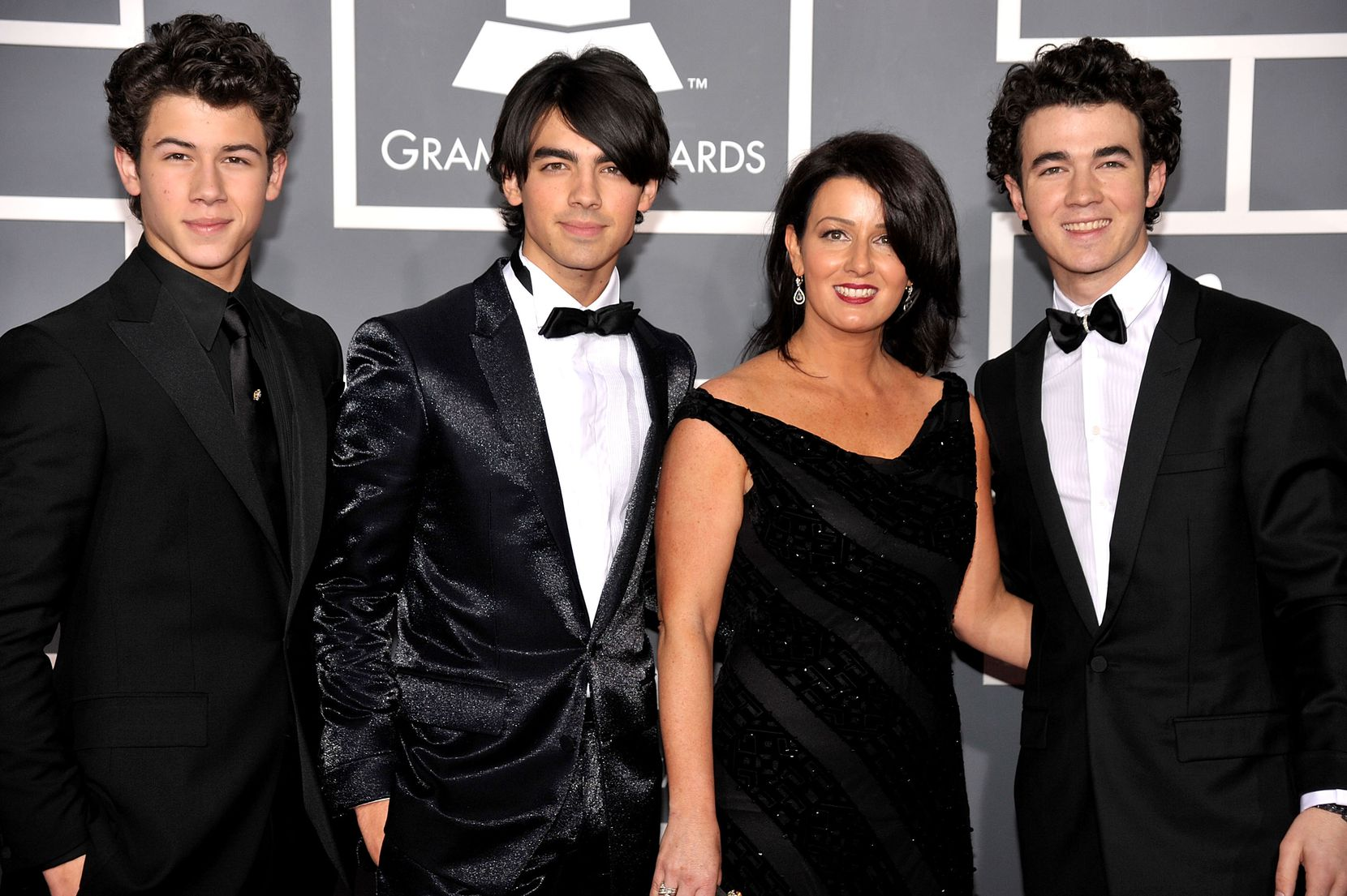 Musicians Nick Jonas, Joe Jonas and Kevin Jonas of The Jonas Brothers with mother mother Denise Jonas arrive at the 51st Annual Grammy Awards held at the Staples Center on February 8, 2009 in Los Angeles, California.
