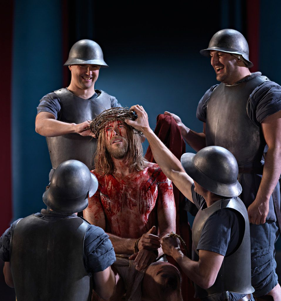Roman soldiers place the crown of thorns on Jesus' head in the Passion Play in the German town of Oberammergau.