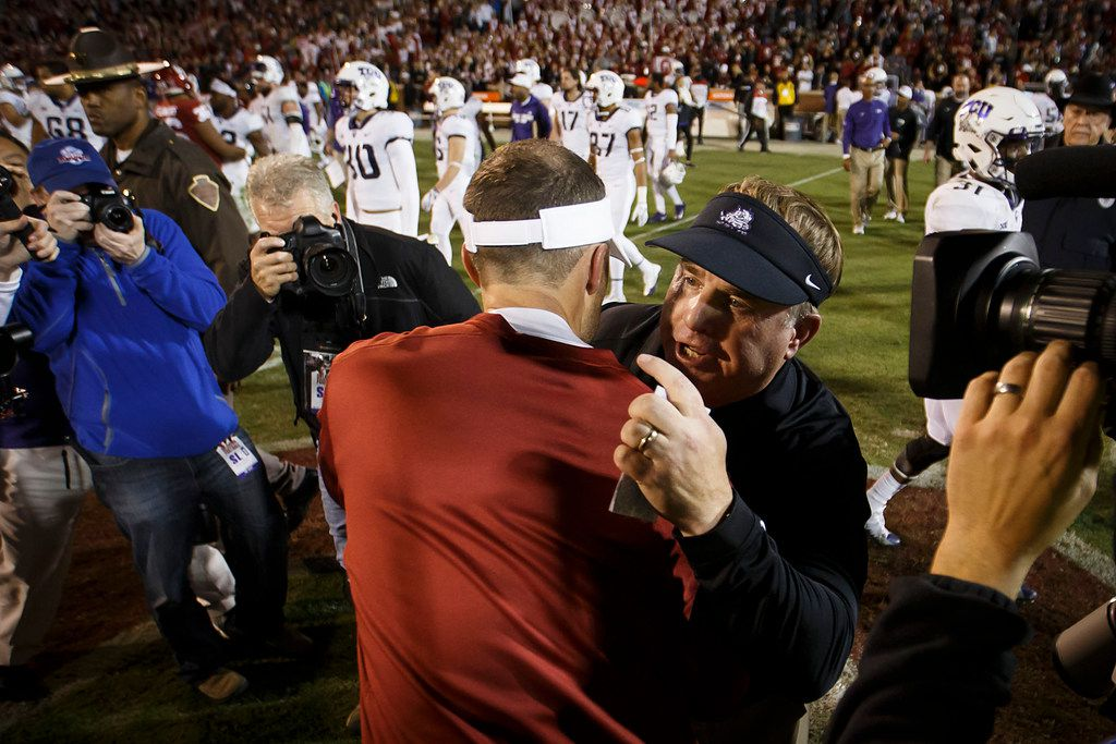 FILE - TCU head coach Gary Patterson hugs Oklahoma head coach Lincoln Riley after the Sooners 38-20 victory in an NCAA football game in Norman, Okla., Saturday, Nov. 11, 2017. (Smiley N. Pool/The Dallas Morning News)