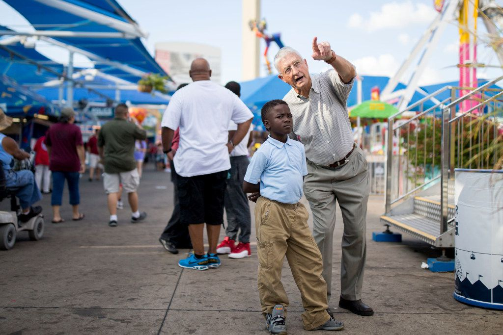 Don Williams, founder of non-profit corporation Foundation for Community Empowerment, interacts with Eric Belin, 9, a student at Paul L Dunbar Elementary School who's while on a field trip visiting the State Fair of Texas at Fair Park on Oct. 19, 2016 in Dallas.