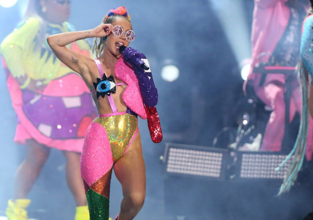 """Miley Cyrus performs at the MTV Video Music Awards at the Microsoft Theater on Sunday, Aug. 30, 2015, in Los Angeles. Ben Ratliff includes her in his book """"Every Song Ever"""" as an example of audio space. (Photo by Matt Sayles/Invision/AP)"""