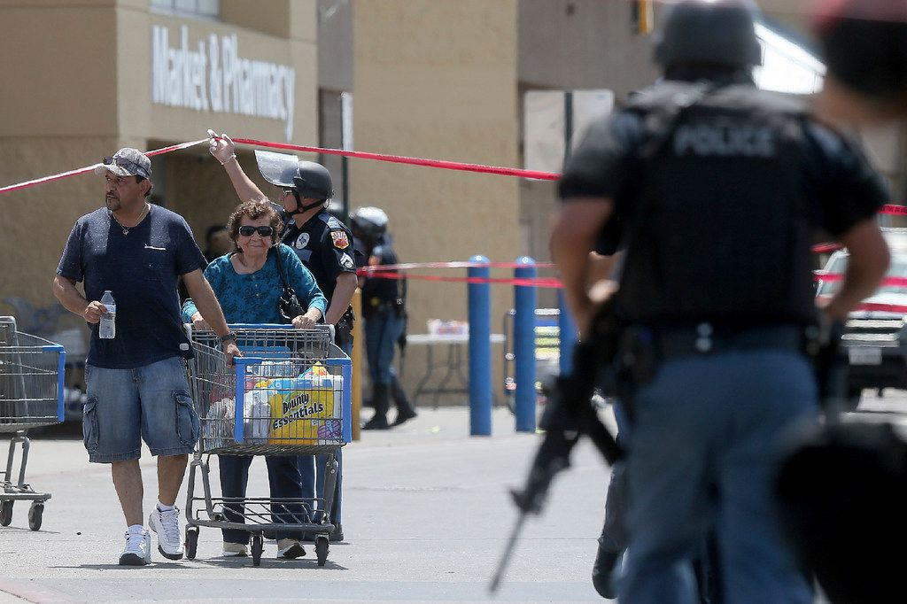 Walmart customers are escorted from the store after a gunman opened fire on shoppers near the Cielo Vista Mall, Saturday, Aug. 3, 2019, in El Paso, Texas. Multiple people were killed and one person was in custody after a shooter went on a rampage at the shopping mall, police in the Texas border town of El Paso said.