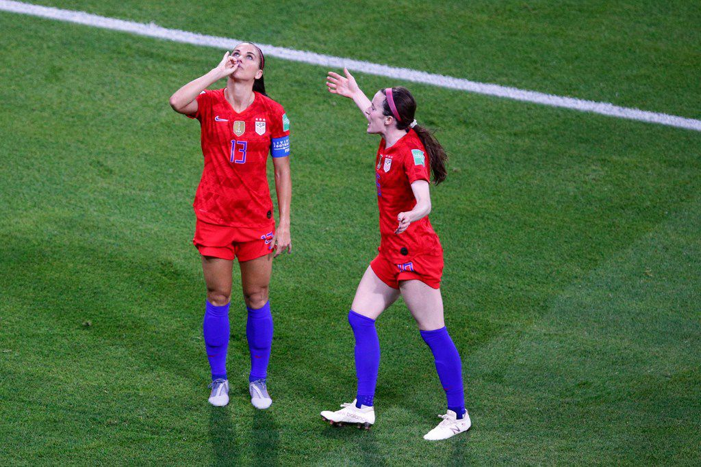 United States' Alex Morgan, left, celebrates her side's second goal during the Women's World Cup semifinal soccer match between England and the United States, at the Stade de Lyon outside Lyon, France, Tuesday, July 2, 2019. (AP Photo/Francois Mori)