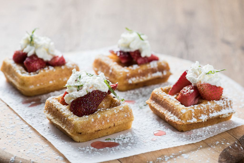 Cru Food and Wine Bar's Mother's Day brunch menu will include mini Belgian waffles with strawberry compote and vanilla whipped cream.
