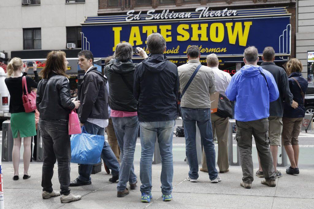 """People assemble outside the Ed Sullivan Theater in New York during the final taping of the """"Late Show with David Letterman"""" on Wednesday."""