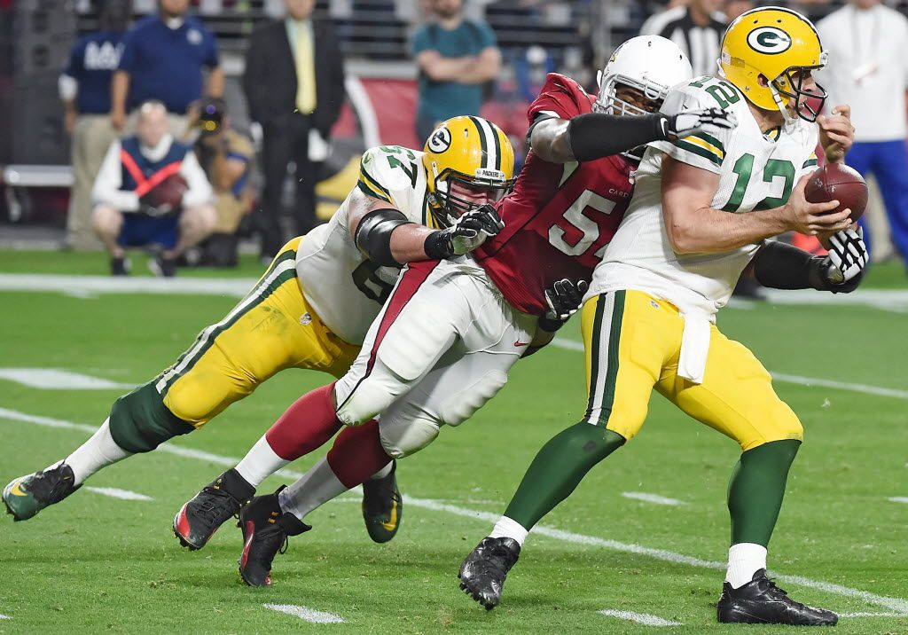 GLENDALE, AZ - DECEMBER 27: Linebacker Dwight Freeney #54 of the Arizona Cardinals of the Arizona Cardinals forces a fumble on quarterback Aaron Rodgers #12 of the Green Bay Packers at University of Phoenix Stadium on December 27, 2015 in Glendale, Arizona.  The Cardinals won 38-8. (Photo by Norm Hall/Getty Images) ORG XMIT: 587463265