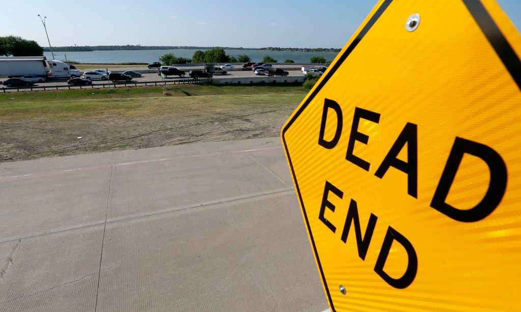 A dead end sign of the Interstate 30 frontage road is seen near Bass Pro Drive as evening traffic backs up on eastbound Interstate 30 in Rowlett. (Jae S. Lee/Staff Photographer)