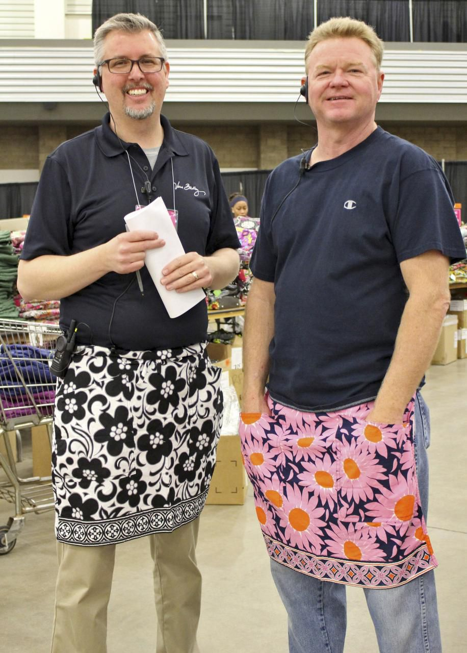 All of the workers at the Vera Bradley Outlet Sale wear aprons, even backstage stockers such as Brian Bates (left) and Scott Wall.
