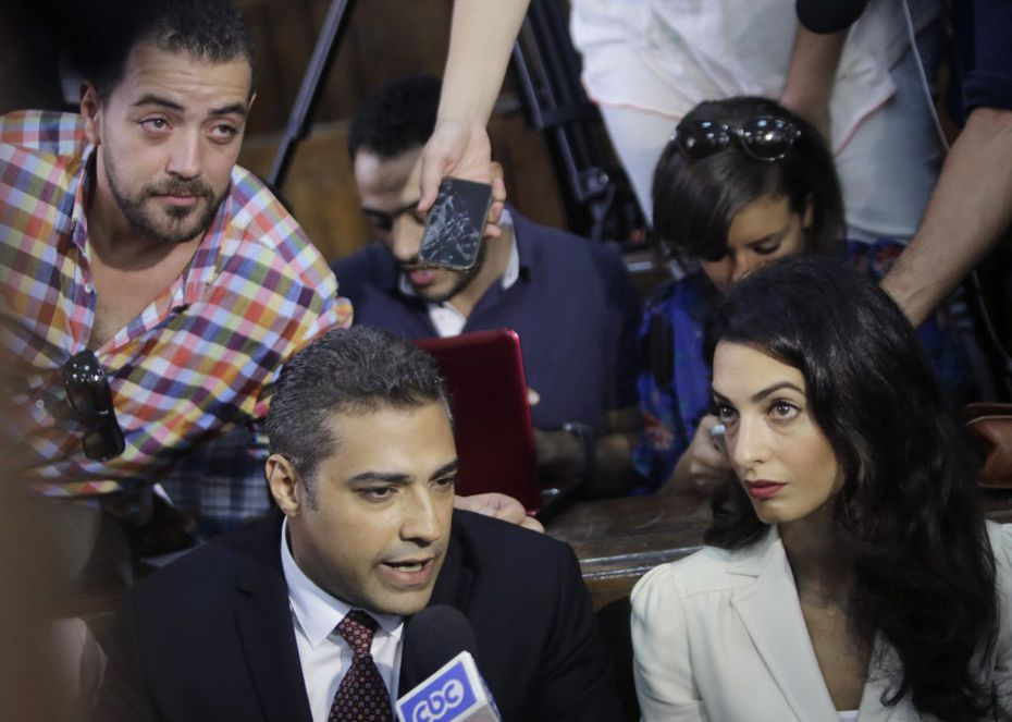 With her client, Canadian Al-Jazeera English journalist Mohammed Fahmy.