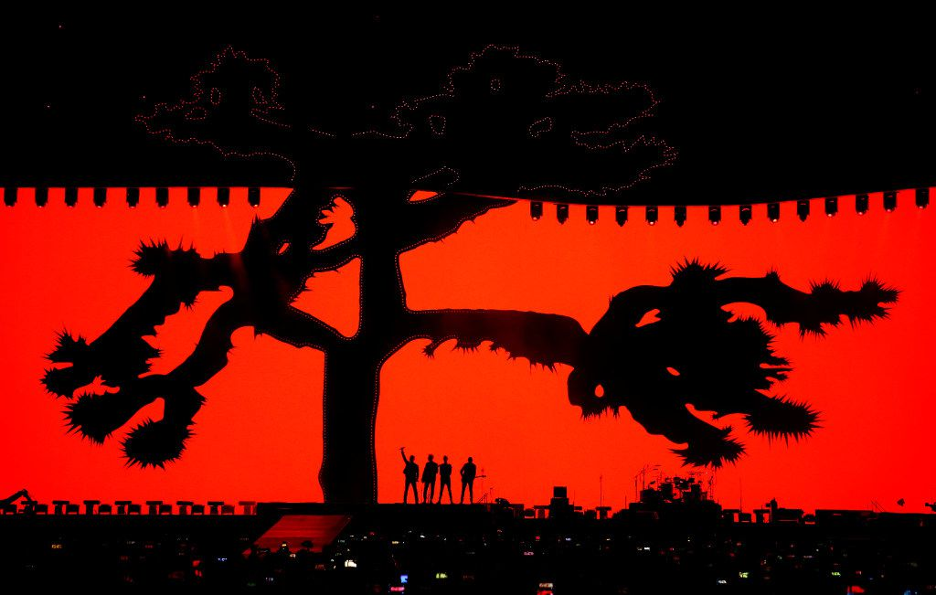 Members of U2 perform on stage at AT&T Stadium in Arlington, Texas, Friday, May 26, 2017.
