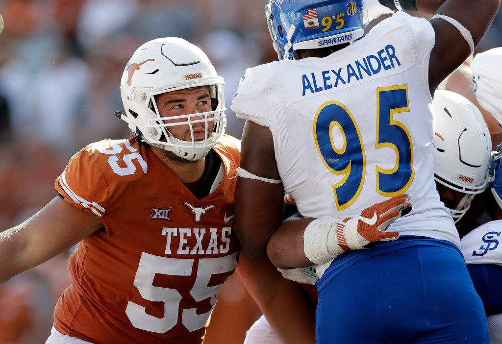 FILE - In this Sept. 9, 2017, file photo, Texas offensive lineman Connor Williams (55) blocks during the second half of an NCAA college football game against San Jose State in Austin, Texas. Williams is expected to play Saturday at No. 24 West Virginia after missing more than seven games with a knee injury.  (AP Photo/Eric Gay, File) ORG XMIT: NYDD316