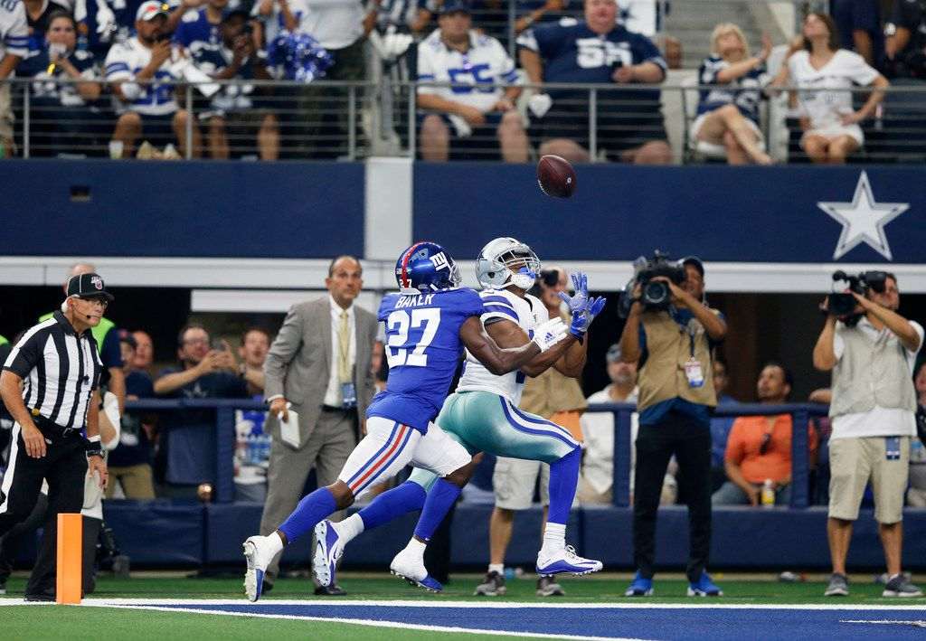 Dallas Cowboys wide receiver Amari Cooper (19) scores a touchdown in front of New York Giants cornerback Deandre Baker (27)  during the first half of play in the home opener between the Dallas Cowboys and New York Giants at AT&T Stadium in Arlington, Texas on Sunday, September 8, 2019.