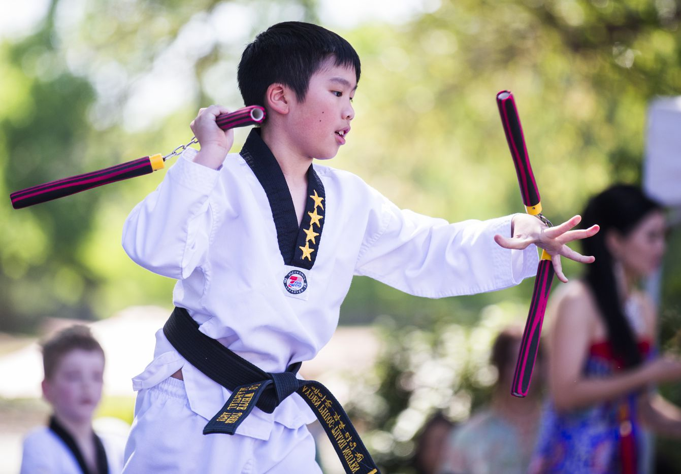 Ayden Nguyen, 11, of US White Tiger Martial Arts of Plano, performs during the 27th Home Depot Asian Festival on Saturday, May 13, 2017 at Cotton Bowl Plaza in Dallas Fair Park.