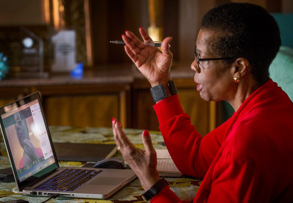 Beverley Wright works from home with a client in Atlanta via a conference app.